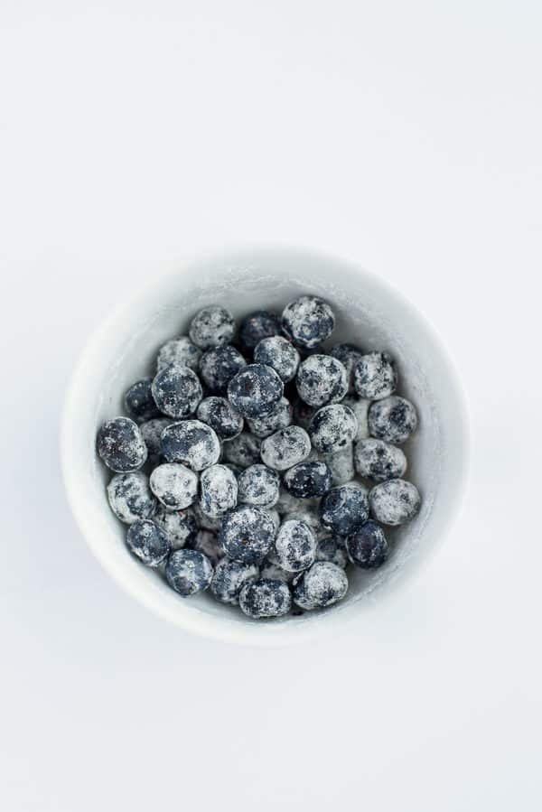 bowl of blueberries coated in flour