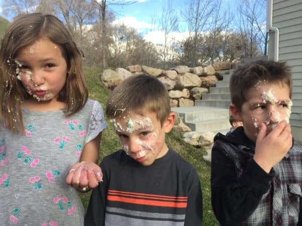 kids with cake on their face