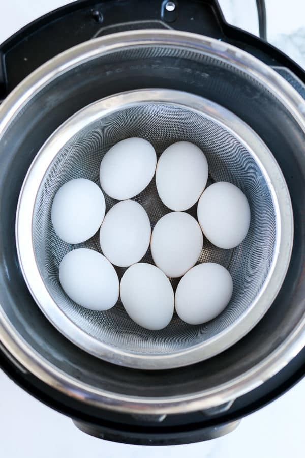 hard boiled eggs in a basket in the pressure cooker