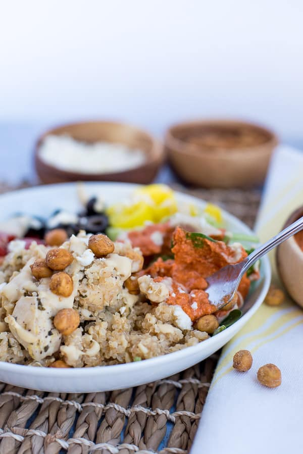Instant pot Quinoa bowl with chicken, tomatoes, olive, peppers with hummus dressing