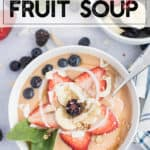instant pot fruit soup in a bowl with fresh berries, coconut, and granola
