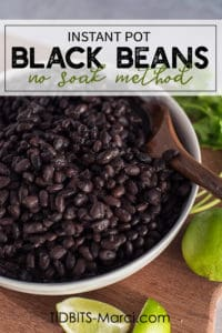 Instant Pot Black Beans in a white bowl with a cilantro