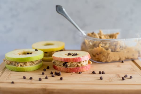 Slices of apples filled with healthy cookie dough