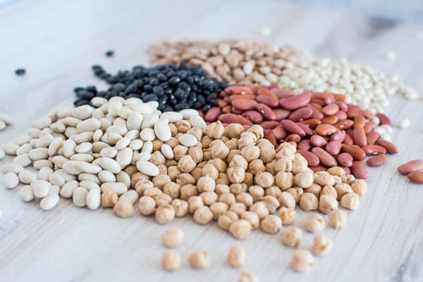 A variety of dried beans on a white surface