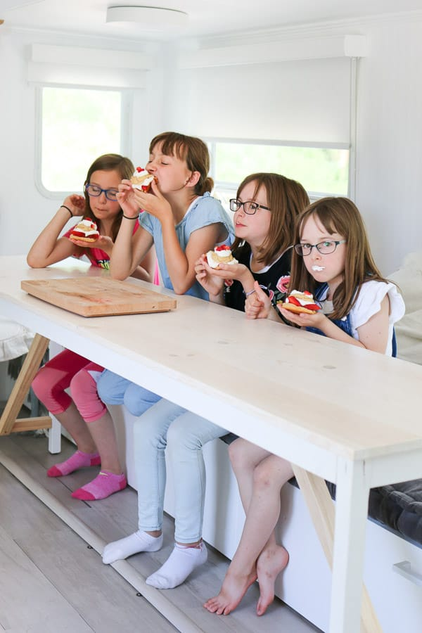 Four girls eating strawberry shortcakes