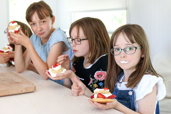 three girls eating strawberry shortcakes