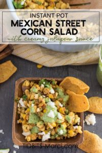 Mexican Street Corn Salad on a white plate with a side of corn chips