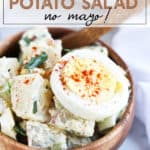 potato salad in a brown bowl with a hard boiled egg