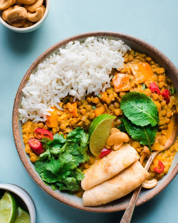 butternut squash with lentils in a bowl with rice and herbs