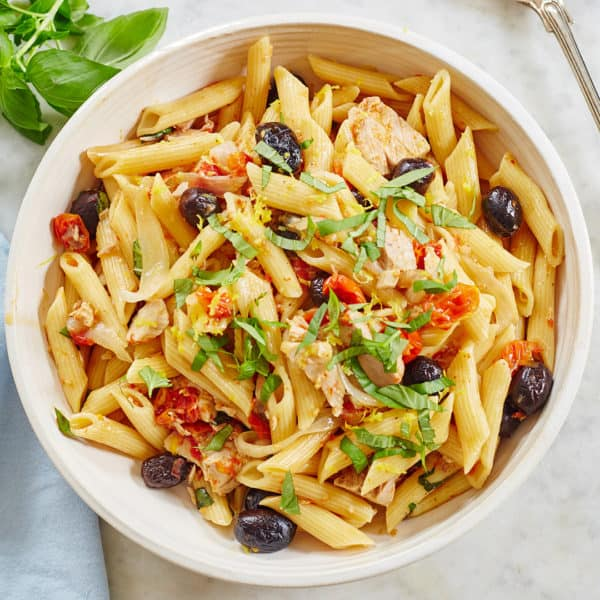 Bowl of pasta with tuna, tomatoes, and olives