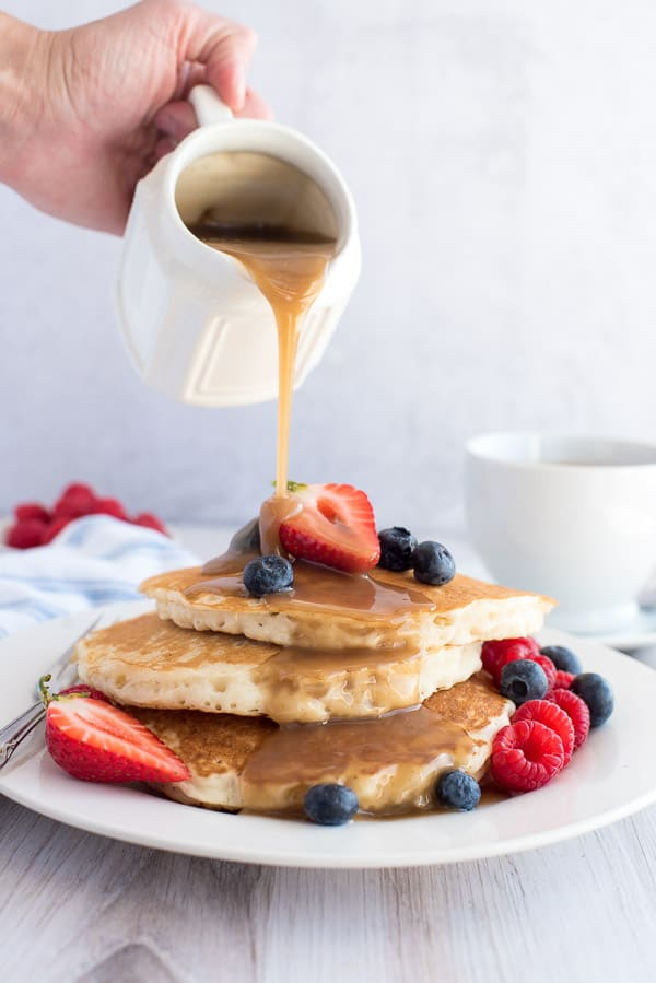 Instant Pot Cinnamon syrup being poured over pancakes