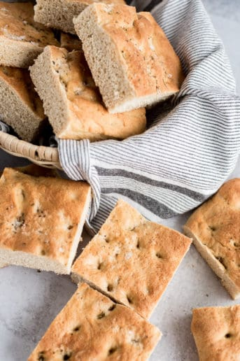 whole wheat focaccia bread in a bread basket