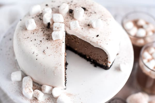 Hot chocolate cheesecake with marshmallow ganache sitting on a white dish