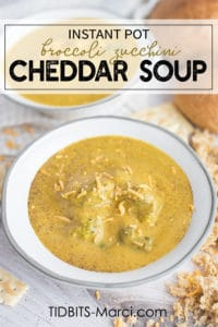 Broccoli Cheddar soup in a bowl with cheddar cheese on top