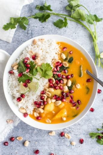 butternut squash soup with rice, cilantro, and pomegranates