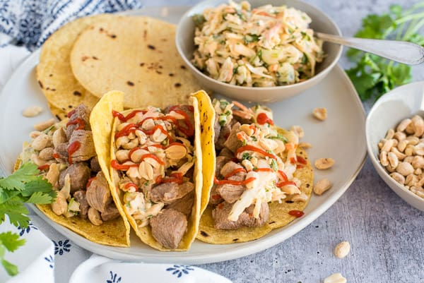 Corn tortillas with pork and coleslaw