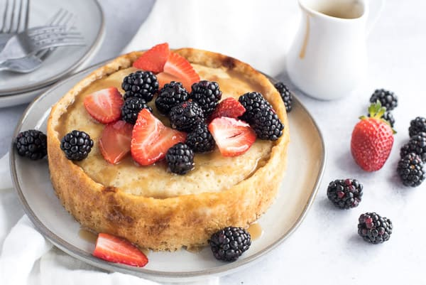 Giant pancake with berries and maple syrup