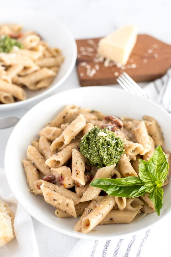bowl of pasta with sun-dried tomatoes and pesto
