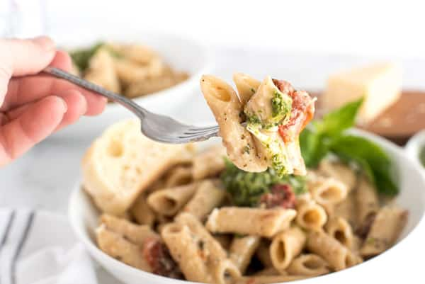fork of pasta with sun-dried tomatoes and pesto