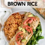 mexican rice with tomatoes in a white dish with enchiladas