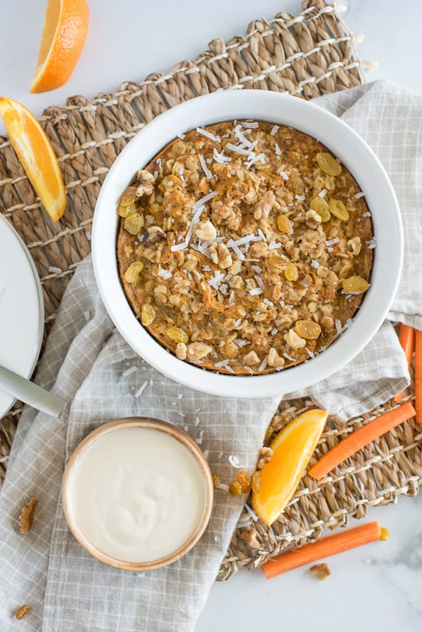 Instant Pot Carrot Cake Oatmeal with white yogurt sauce and orange slices