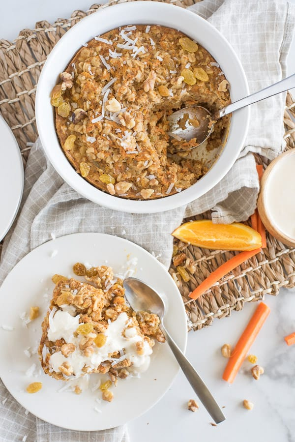 Instant Pot Carrot Cake Oatmeal on a white plate with white yogurt sauce over top