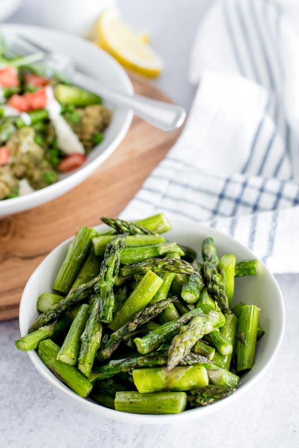 Bowl of asparagus in a white bowl