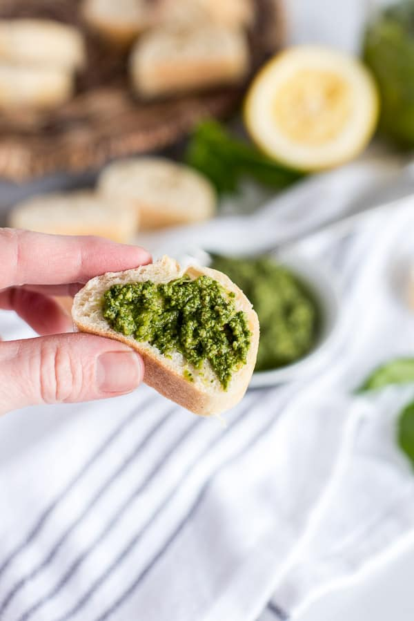 slice of bread with pesto on top