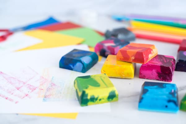 Square crayons of many different colors