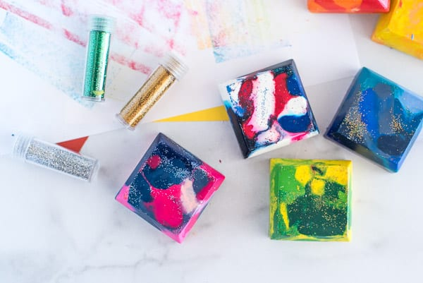 Square crayons of many different colors with glitter