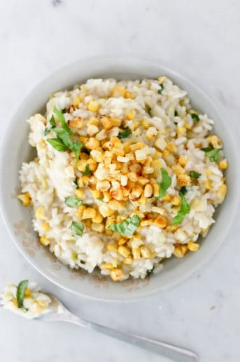 risotto topped with corn and basil