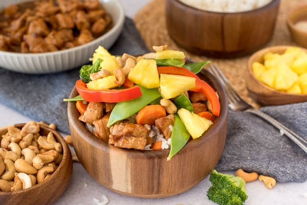 wood bowl with teriyaki chicken, rice, and vegetables