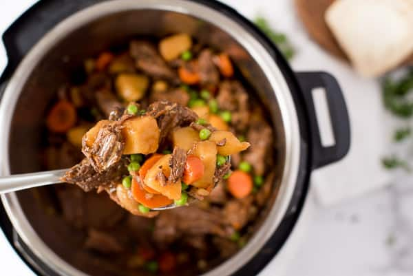 Beef stew with carrots, peas and onions in an Instant Pot