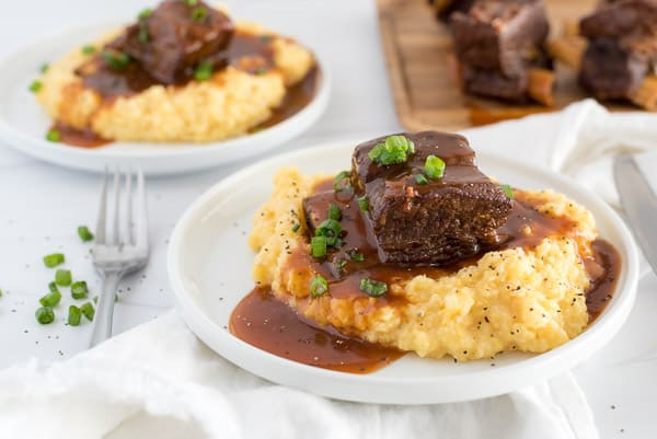 short ribs served over polenta with gravy over top